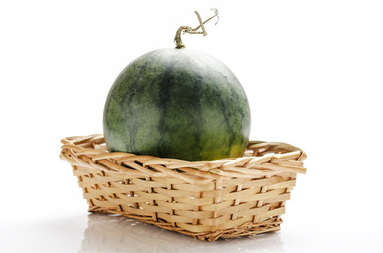 still-life photo of watermelon in a basket