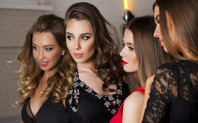 Close up portrait of four beautiful glamorous models in studio