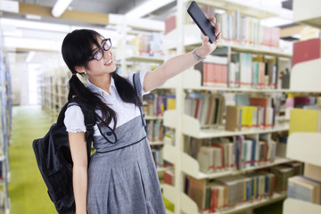 Female student taking self portrait