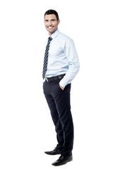 Confident businessman posing over white