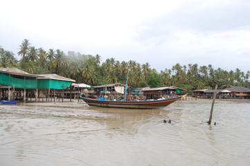 Boat floating while storm raining at Fishing village
