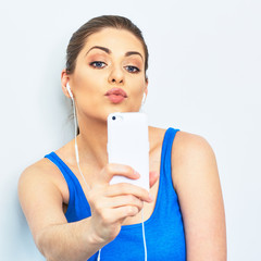 Kiss selfie on mobile phone. Young woman portrait.