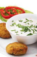 Indian food: yogurt salad and vegetable pies.