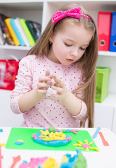 Little Girl Playing with Color Play Dough