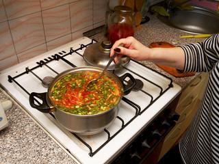 cooking Ukrainian borsch in a pot