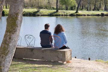 The harmony of a couple looking at the river for a while