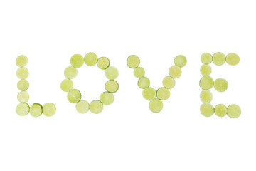Sliced limes forming the word love, on a white background