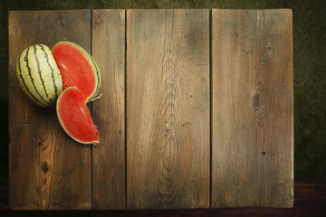 Fresh watermelon at a picnic table background