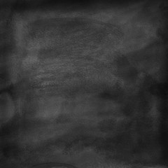 A cleaned blackboard. Wet sponge and chalk traces are visible.