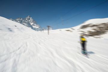 Blurred motion skiing in scenic alpine resort
