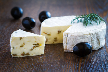 Piece of Brie Cream Cheese with olives