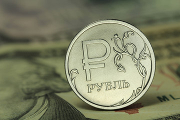 coin in one Russian ruble on a background dollars background