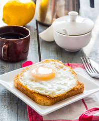 crispy toast with a fried egg and a cup of coffee. English break