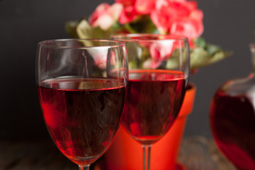 glass with red wine and flower