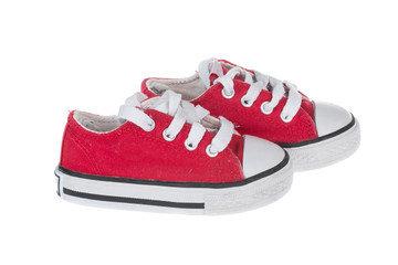 Cute red baby sneakers, isolated on white