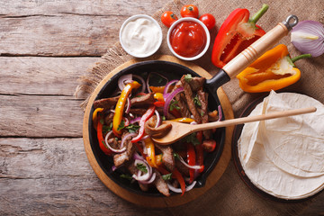 Mexican fajitas on a table. horizontal top view