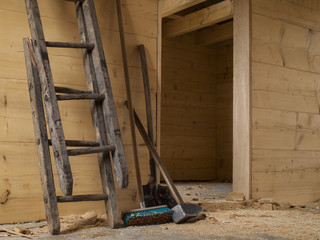 big hammer, broken wooden ladder, shovel and brush