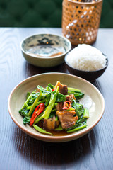 Thai foods. Crispy pork belly with Chinese brocoli