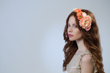 Beautiful girl with red hair and flowers