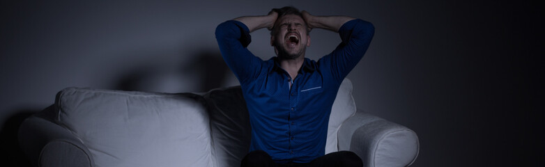 Despair man screaming loudly