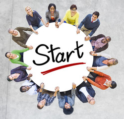 Group of People Holding Hands Around Letter Start