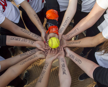 Girls Fastpitch Softball Team Inspirational Huddle Before Game