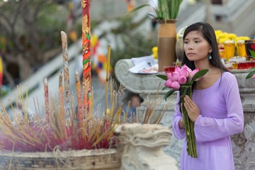 Pretty Vietnamese girl praying
