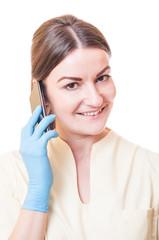Medical assistant holding smartphone