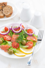 fresh salad with salted salmon, vertical
