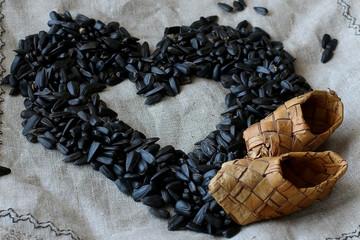 sunflower seeds wicker basket on linen background
