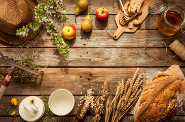 Natural local food products on vintage wooden table - rustic composition captured from above....