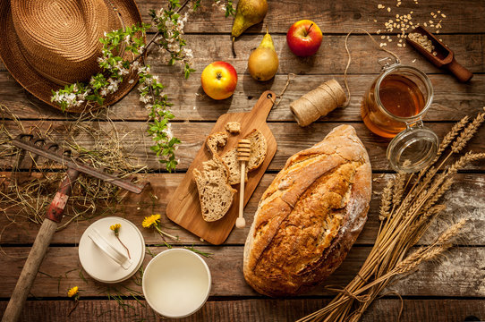 Natural local food products on vintage wooden table - rustic composition captured from above. Country lifestyle, rural vacation or agritourism concept.