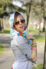 Young girl posing with a colorful bandana