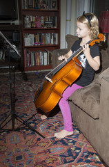 Little girl playing a cello