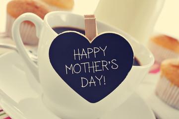 breakfast and happy mothers day written in a heart-shaped blackb
