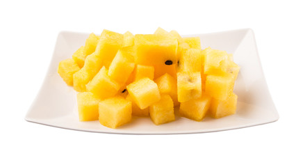 Bite sized yellow watermelon in a white plate