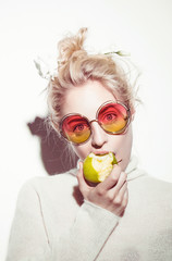 portrait of cheerful blonde hipster girl going crazy making
