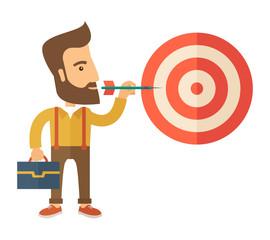 Working man holding a target arrow