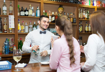 females  chatting and drinking wine in bar