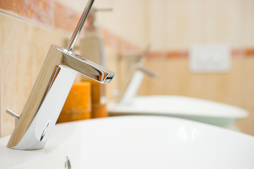 modern bathroom with sink and faucet, blurred background