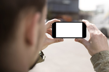 Man taking photos with smartphone