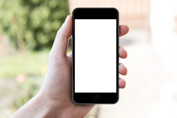 Man's hand shows mobile smartphone in vertical position,
