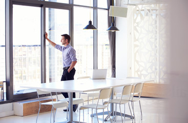 Young man in empty meeting room
