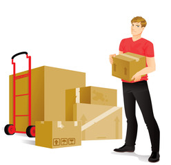 Young man holding a box is ready to move in a new place