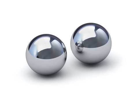 Two glossy metal spheres with clipping path