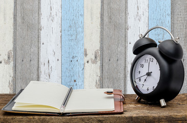 Still life of clock notebook at home