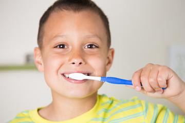 Boy brushing his teeth.