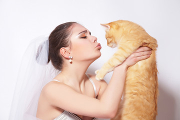 Beautiful bride with red cat