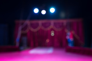 Indoor stage with spotlights and pink decor
