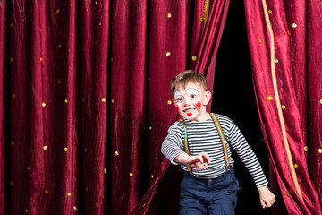 Happy little boy actor making his entrance